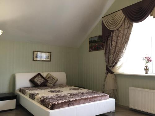 A bed or beds in a room at Гостевой дом на Истринском водохранилище