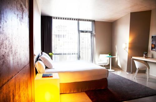 A bed or beds in a room at Hotel Viura