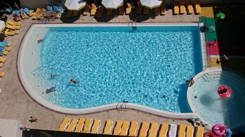 A view of the pool at Hotel Avrora or nearby