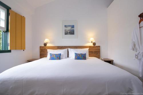 A bed or beds in a room at Pousada do Príncipe