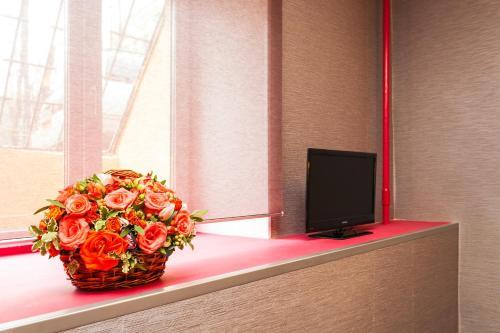Телевизор и/или развлекательный центр в Отель Кастелло