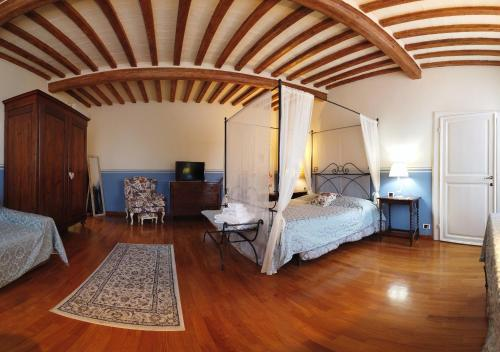 A bed or beds in a room at Attico sulla Torre