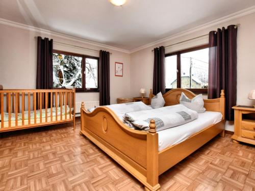 A bed or beds in a room at House in the Belgian countryside, ideal base for many fine excursions