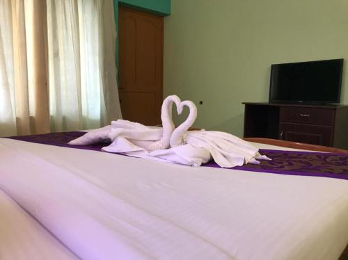 A bed or beds in a room at Seawin Beach Resort