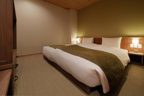 Łóżko lub łóżka w pokoju w obiekcie Onyado Yuinosho