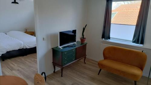 Een TV en/of entertainmentcenter bij De Welvaart - Hotel Restaurant