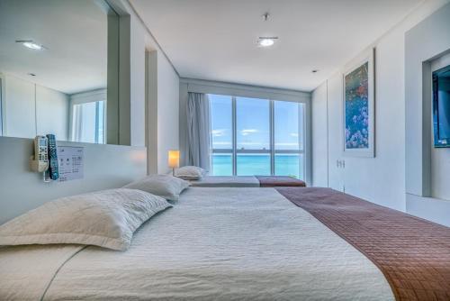 Cama ou camas em um quarto em Hotel Brisa Praia