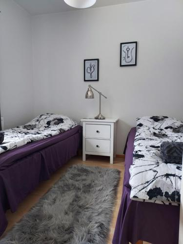 Vuode tai vuoteita majoituspaikassa Vaahteramäki Guesthouse