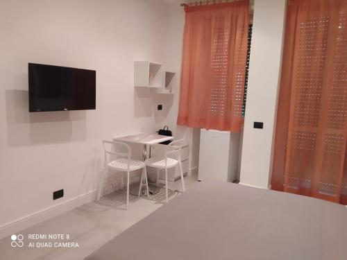A television and/or entertainment center at Flaminio Holidays