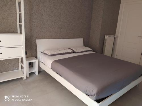 A bed or beds in a room at Flaminio Holidays
