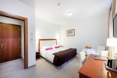 Ein Bett oder Betten in einem Zimmer der Unterkunft Hotel Federale