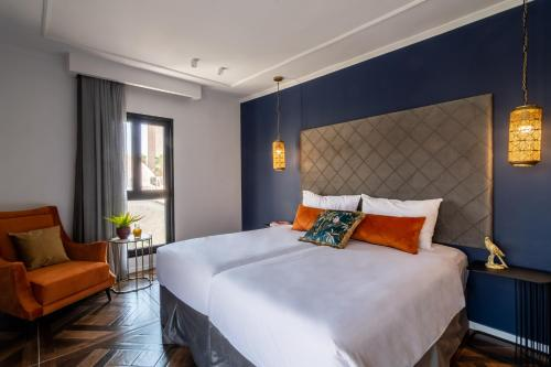 מיטה או מיטות בחדר ב-מלון אלדן