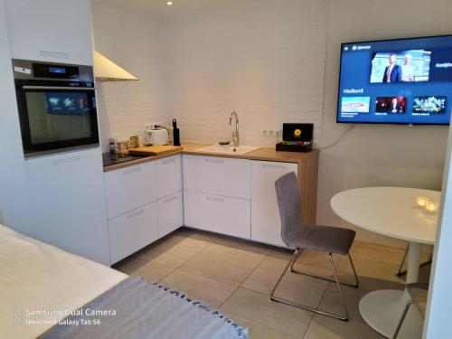 A kitchen or kitchenette at Centrum Apartment