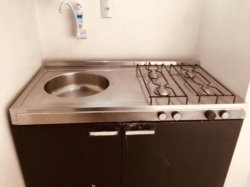 A kitchen or kitchenette at Studio Centro São Leopoldo