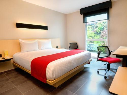 Cama o camas de una habitación en City Express Plus Cali