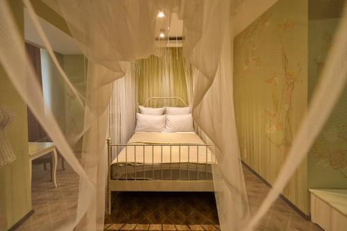 A bed or beds in a room at Hotel VILLA de IDALGO