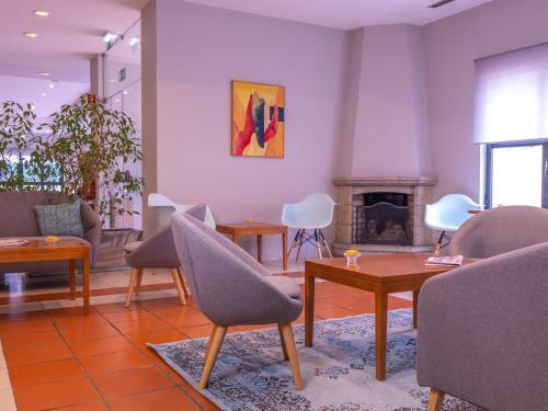 Uma área de estar em Flag Hotel Braga