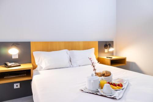 Uma cama ou camas num quarto em Flag Hotel Braga
