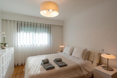 Uma cama ou camas num quarto em Porto Gaia RR Apartment by MP