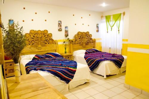 A bed or beds in a room at Hacienda los Algodones