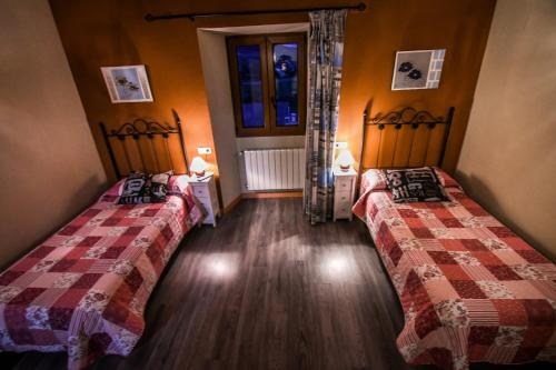 A bed or beds in a room at aCienLeguas