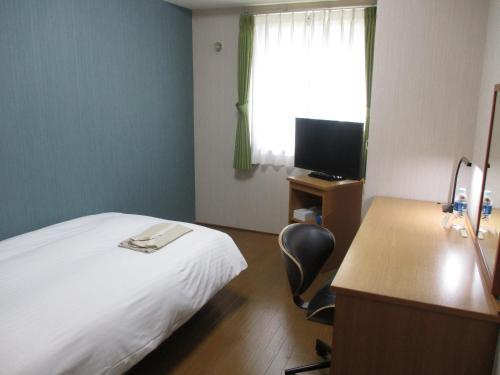 A television and/or entertainment center at Seaside Hotel Twins Momochi
