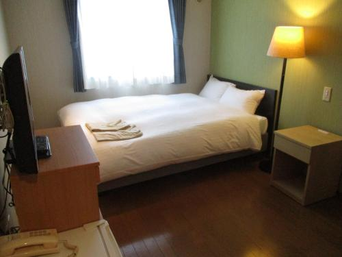 A bed or beds in a room at Seaside Hotel Twins Momochi