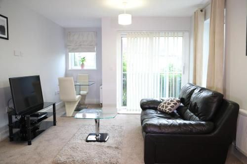 A seating area at Letting Serviced Apartments - Charrington Place, St Albans