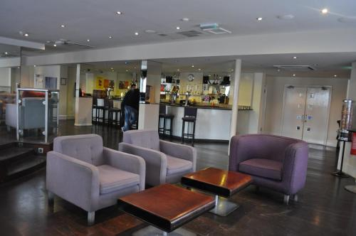 The lobby or reception area at Plough Hotel