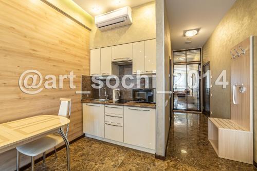 Кухня или мини-кухня в Apartment Actor Galaxy