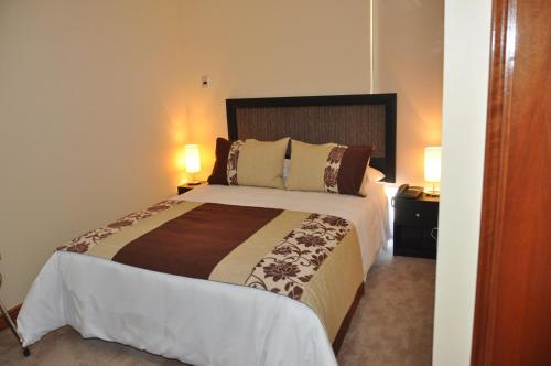 A bed or beds in a room at Nuevo Hotel Constitucion