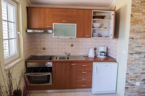 Kuchyňa alebo kuchynka v ubytovaní Apartment Banjol 23