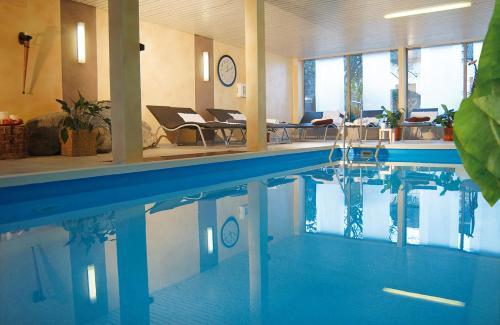 The swimming pool at or near Gästehaus Hubertus Garni