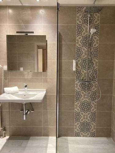 Salle de bains dans l'établissement Le Relais De La Haute Sambre