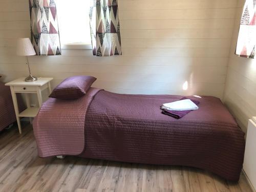 Säng eller sängar i ett rum på Björkedal