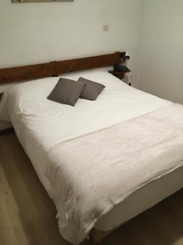 Un ou plusieurs lits dans un hébergement de l'établissement Le Relais de la Forge