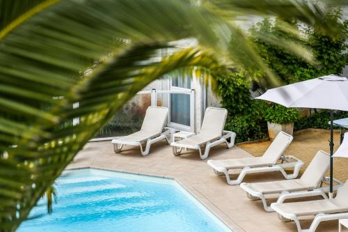 The swimming pool at or near Hôtel Restaurant La Forestière