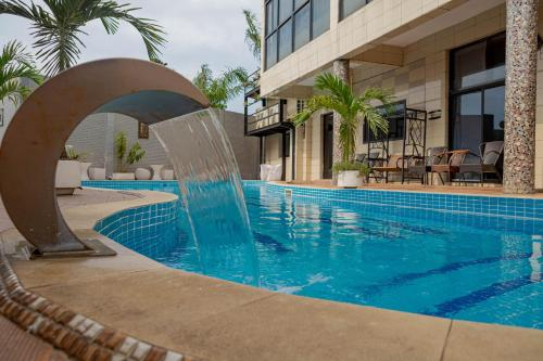 The swimming pool at or near Hotel Hibiscus Louis