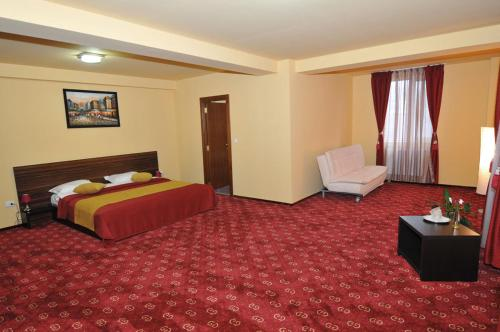 A bed or beds in a room at Hotel GClub
