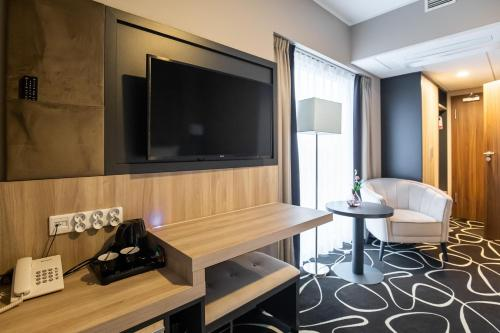 A television and/or entertainment center at Trofana Wellness & SPA