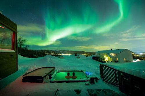 A view of the pool at Aurora Borealis Observatory or nearby