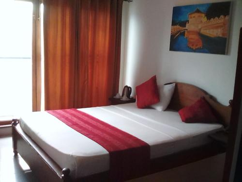 A bed or beds in a room at Heaven Seven Kandy