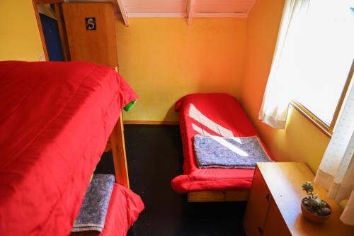 Una cama o camas en una habitación de Hostel Wenüy