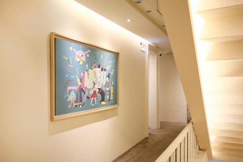 A television and/or entertainment center at Dandy Hotel - Tianjin Branch