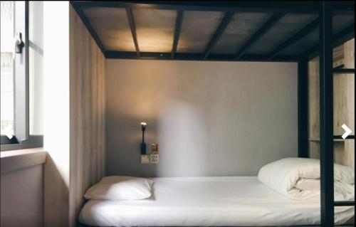 A bed or beds in a room at LuckyOne Hostel