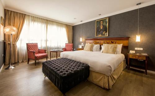 Кровать или кровати в номере Eurostars Araguaney