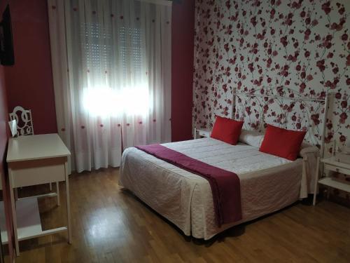 Un ou plusieurs lits dans un hébergement de l'établissement Hostal Los Escudos