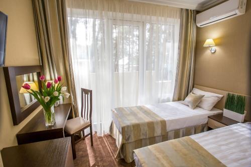 Кровать или кровати в номере Парк Хаус Отель