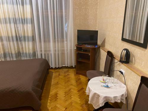 Телевизор и/или развлекательный центр в Мини отель, гостиный двор «Байкал»