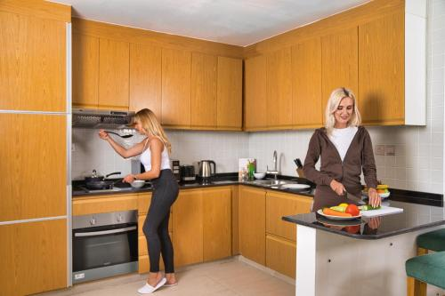 A kitchen or kitchenette at Grand Heights Hotel Apartments